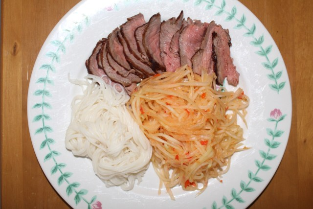 Steak and somen noodles with Thai papaya salad.