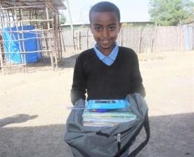 Yeabsira Ambiko new SS student in Bonosha with his school supplies in Feb 2018