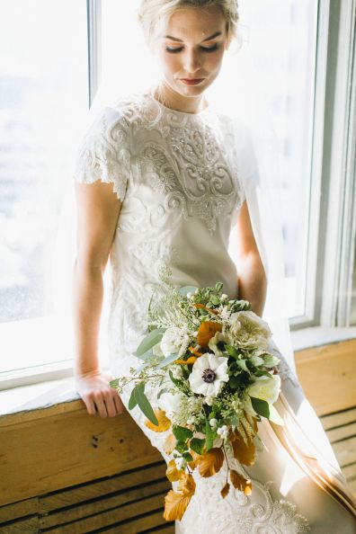 A real wedding bouquet by Roots Floral Design. Photo by Burlap and Blossom Photo
