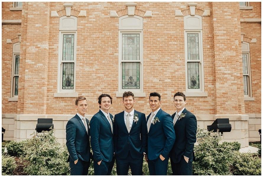 Blue suits succulents groomsmen