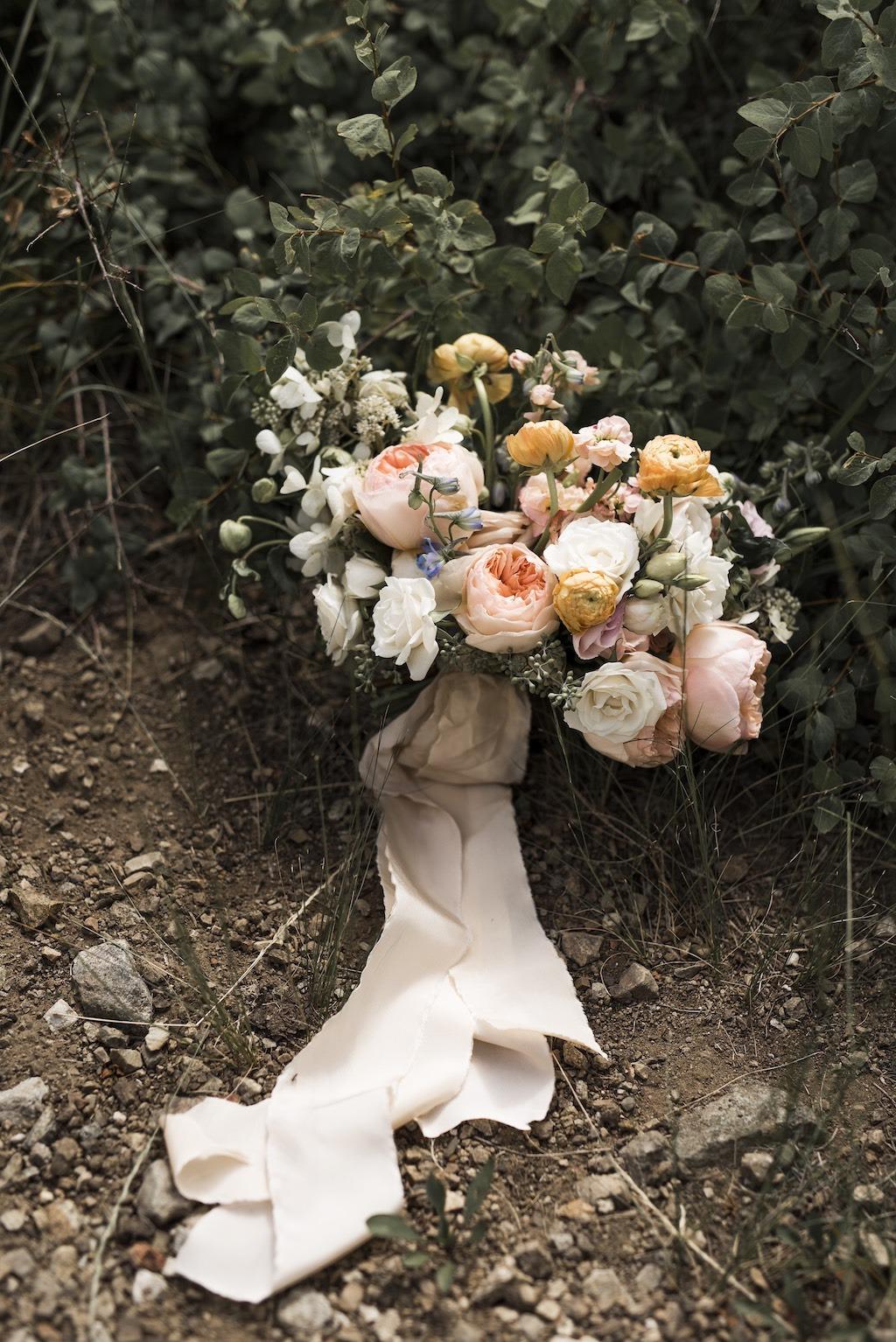 Peach cream orange light blue wedding flowers