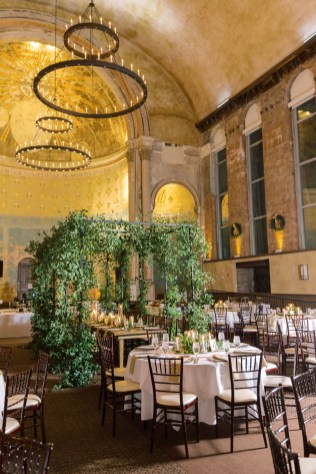 a large greenery canopy covers the head table at the monastery event center in cincinnati