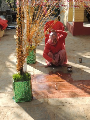 A relative of the bride paints the floor in preparation for a wedding ritual. This wedding was between Indu, one of the daughters of Joginder, my landlady's gardener.