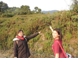 Marie and Cheryl pointing out the top of the mountain we climbed!
