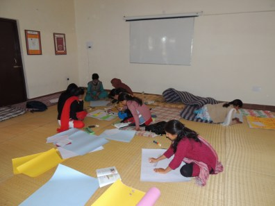 Poster making and practicing for the play.