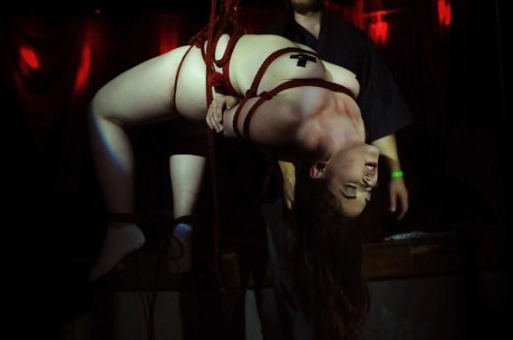 Shibari red rope Clover in bondage suspension