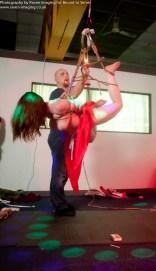 Wax play while in face down shibari bondage suspension.