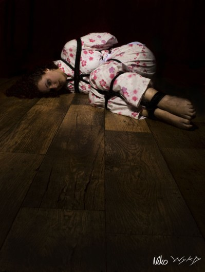 Molly Dolly bound helpless on the floor in shibari bondage