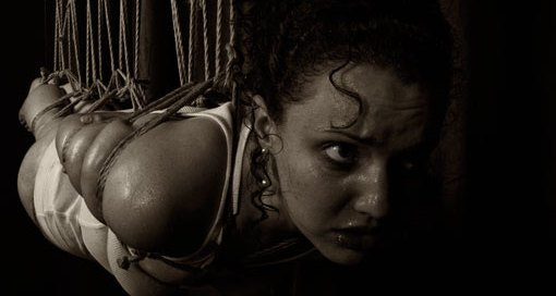 Molly Dolly sweating in multi point shibari suspension bondage