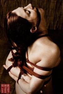 Tightly bound kinbaku bi. Gote shibari. Hair bondage.