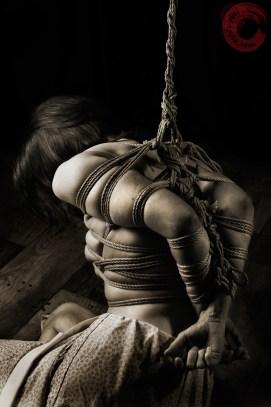 Tight bondage partial suspension shibari