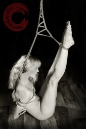 Exposed shibari, vulnerable positon