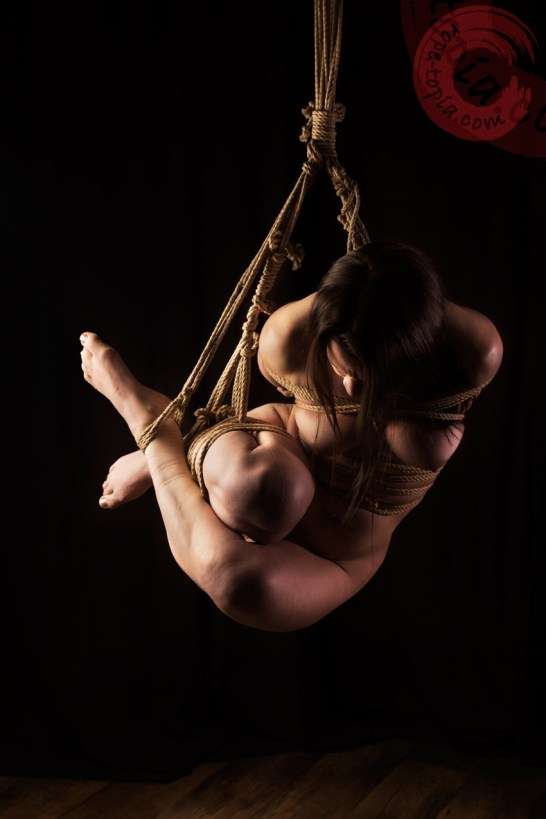 Twisted ball tie shibari bondage.
