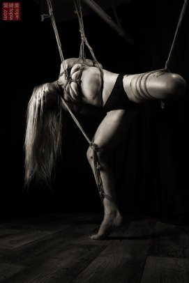 Torturous partial suspension in shibari bondage, takatekote, futomomo, neck rope