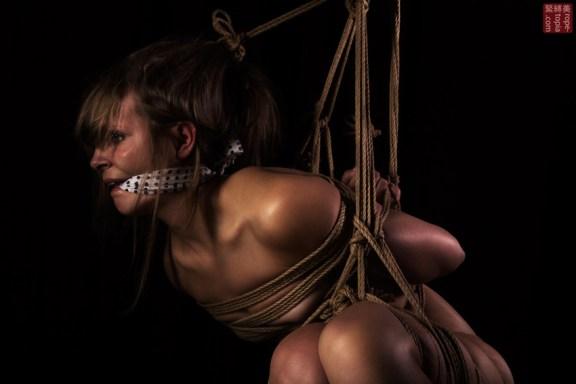 Shibari suspension bondage gagged and bound