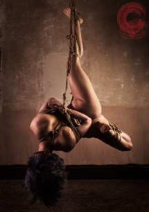 Full shot shibari suspension with rope gag