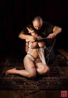 Rope release. Shibari comes undone.