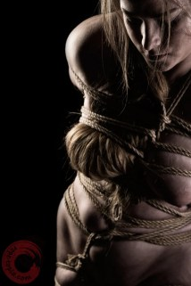 Bound breasts and hair, organic rope bondage.