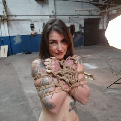 Adreena @adreena_winters looking cute while tied during our rope bondage porn shoot to Hustler's Taboo magazine. #rope #shibari #bondage #porn #tattoos #tattoedgirl
