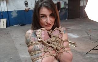 Adreena @adreena_winters looking cute while tied during our rope bondage porn shoot to Hustler's Taboo magazine. #rope #shibari #bondage #porn #tattoos #tattoedgirl