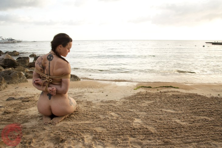 Think about it. Shibari bondage on the beach at BeachBind Hedonism 2 Jamaica. WykD Dave & Clover