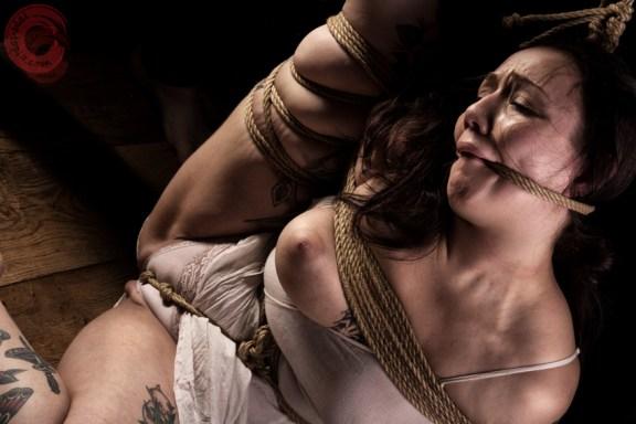 Sophia Shibari rope gagged and crotch ropped in hard rope bondage
