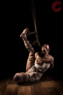 Sophia Shibari hard tied, rope gagged, neck roped stretched exposed with hard crotch rope.