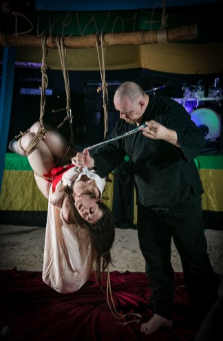 Water torture during kinbaku / shibari bondage show at Beach Bind in Jamaica