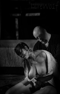 Intense moments after hard kinbaku /shibari bondage suspension show