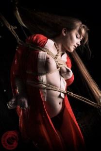 Tied in rope, hair bondage. Model Ankrah