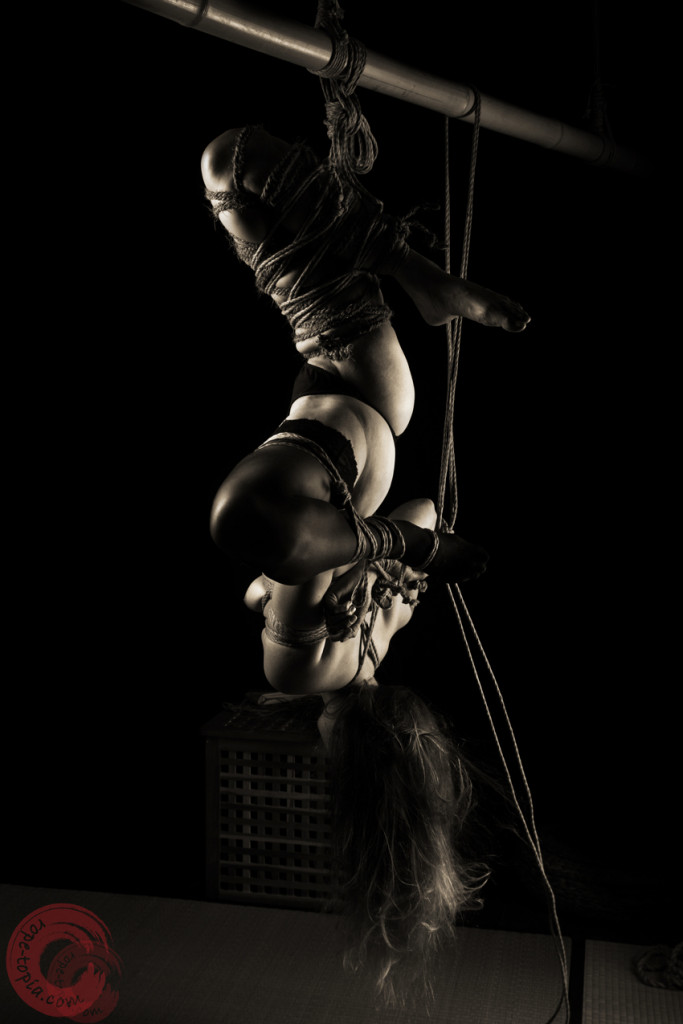 Tied suspended inverted and exposed, hard futomomo torture leg. Coconut rope bondage.