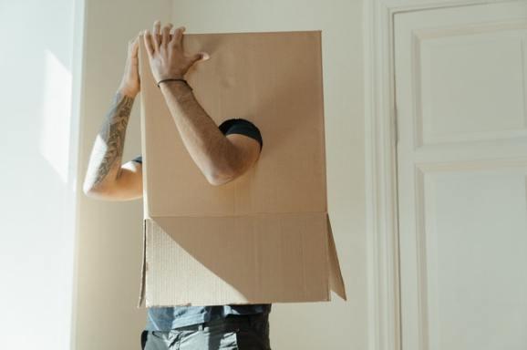 Person wearing a cardboard box on their head