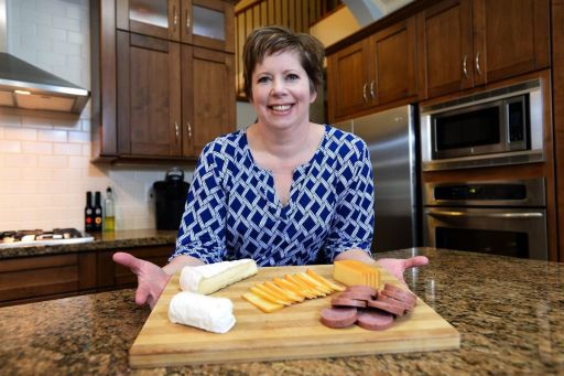 Pathologist Dr. Barbra Allen Bradshaw, seen in her Abbotsford, B.C., kitchen on Dec. 28, is part of a group of doctors from across the country who have been on a crusade to change the way Canadians are told to eat — urging colleagues and regular Canadians alike to eat fewer carbohydrates than what's recommended by the government and indulge in fat from sources such as steak and cheese.