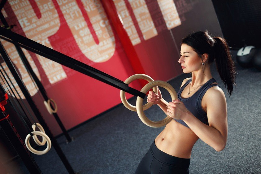 A lady demonstrates one of my favourite bodyweight exercises, the ring row