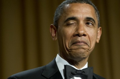 US President Barack Obama winks as he te