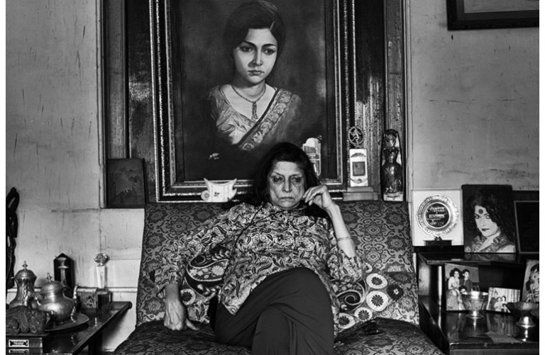 Woman with Portrait And they all sat down by Bikramjit Bose