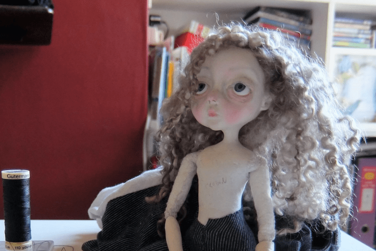 Doll waiting to be dressed by Sam Crow