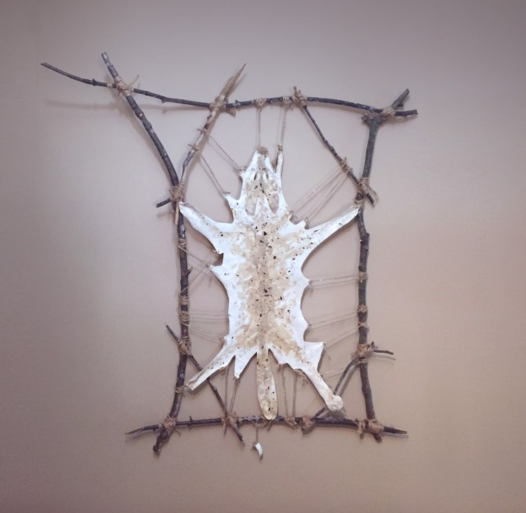 Emily Schnall Killing of the Honshu Wolf Sculpture Paper, rope an wood.jpg