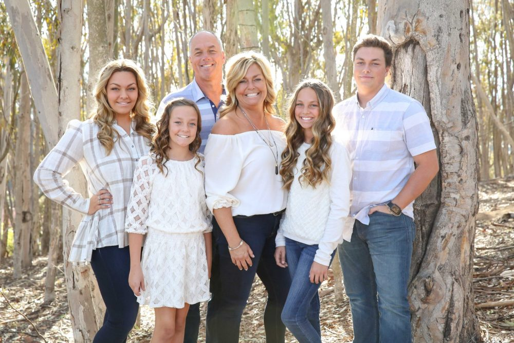 Holiday photo of the Behrens Family set in the woods