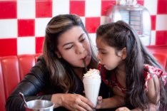 Mother and daughter share a shake at Busy Bee Cafe in Ventura, CA