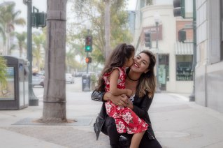Daughter kissing mother in Downtown Ventura, CA
