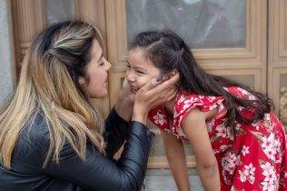 Mother embracing daughter in Downtown Ventura