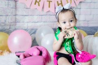 One Year Cake Smash Baby Boxer Girl Sitting Biting WBC Medal