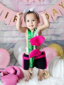 One Year Cake Smash Baby Boxer Girl Standing