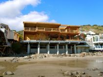 a monster sized home being built on the beach