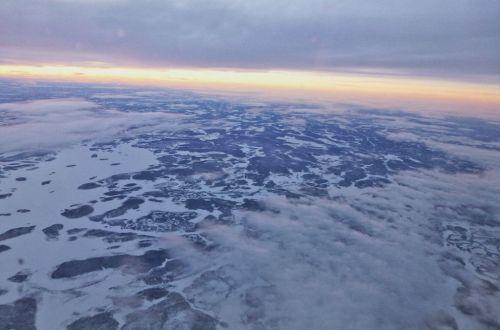 Finnland von oben Flugzeug Schneelandschaft
