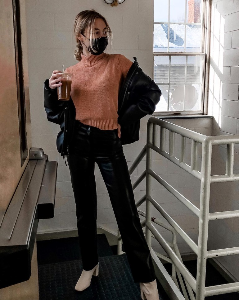 Outfit in stairway wearing aritzia leather pants