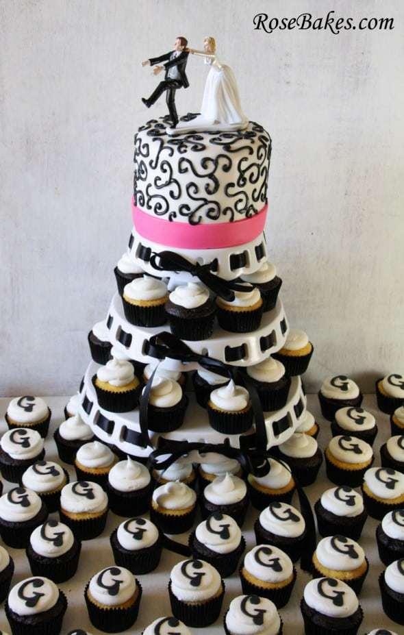 https://i2.wp.com/rosebakes.com/wp-content/uploads/2013/03/Black-Hot-Pink-Wedding-Cake-Cupcake-Tower-with-Monogram-590x927.jpg