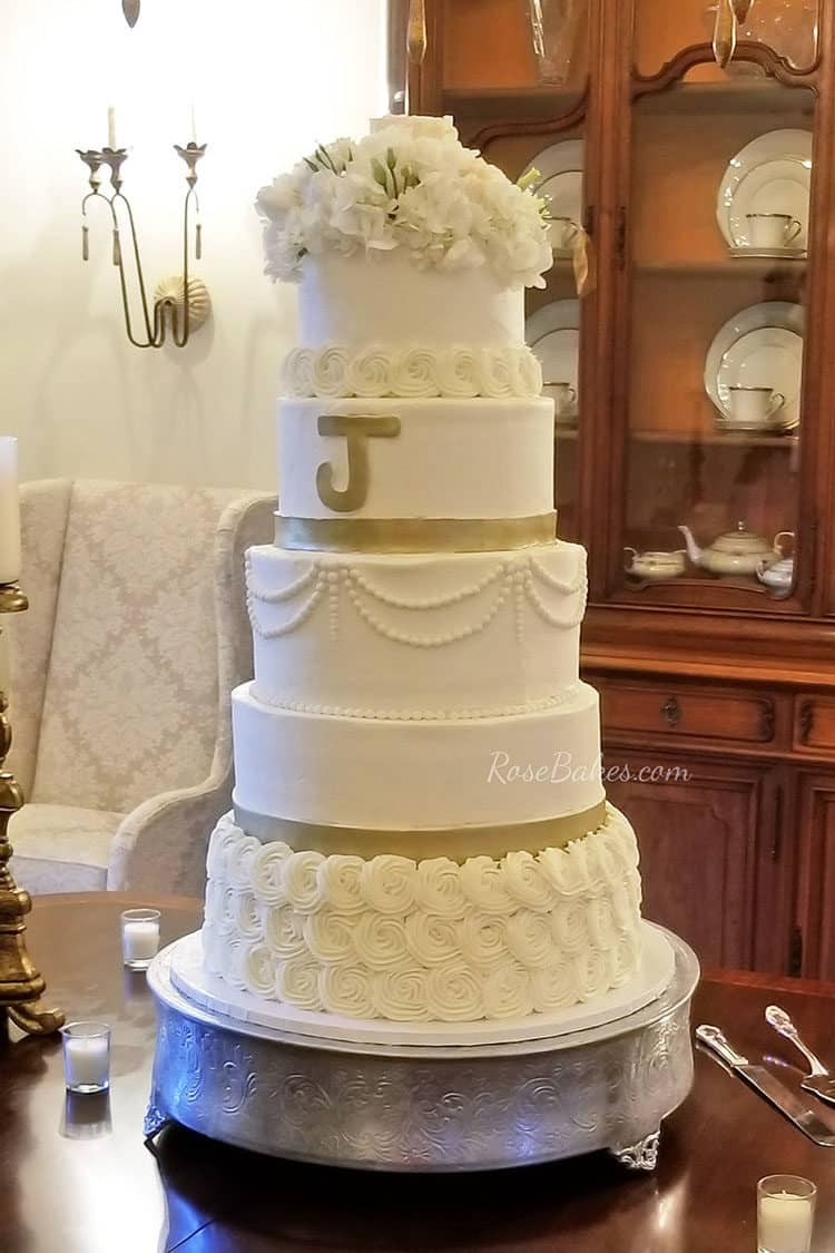 The 6 tier buttercream wedding cake that wasn t meant to be    Rose     Since the cake was to have the block letter on the front and should ve had  3 gold bands  on alternating tiers   I had to change it up a bit so the  design