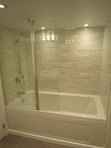 Apartment oversized bath with natural marble surround